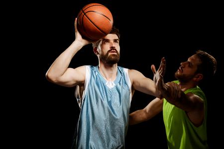 Athletic men playing basketball