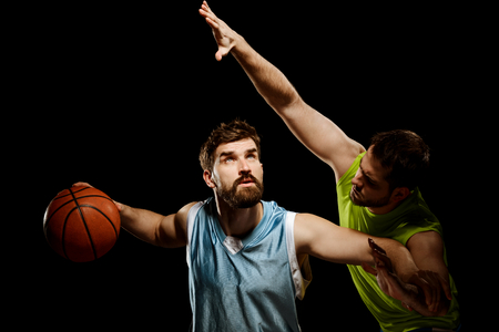 Basketball players isolated on black Stock Photo