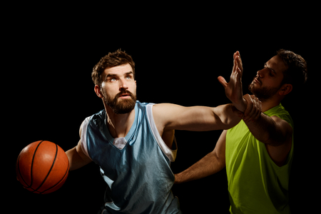 Two opposing basketball players Stock Photo