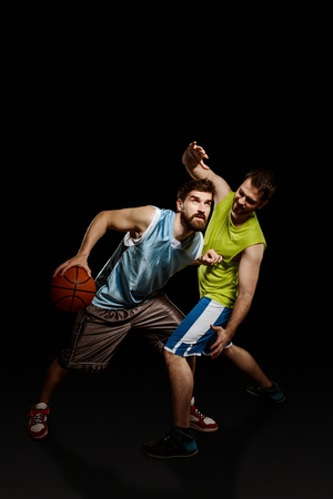 Opponent basketball players in action Stock Photo
