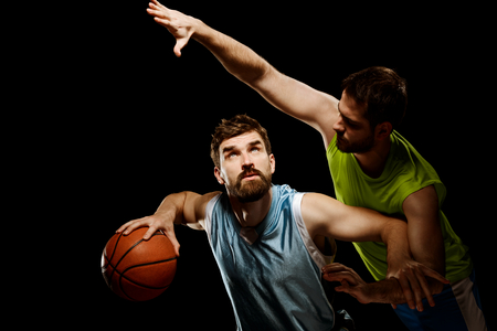 Basketball player struggles with opponent Stock Photo