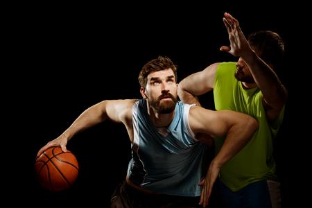 Player dribbling towards the basket