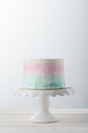 Three color cake on stand Stock Photo
