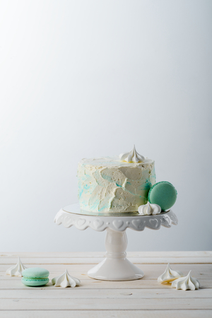 Cake on stand and meringues