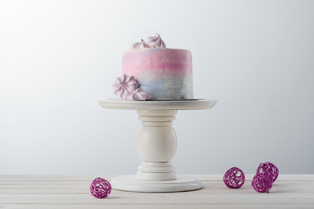 Cake, meringues and wire balls Stock Photo