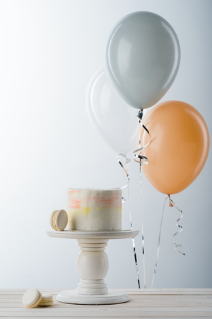 Balloons and cake on stand