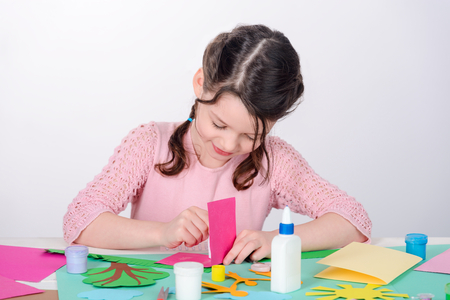 Young lady creates a card Stock Photo