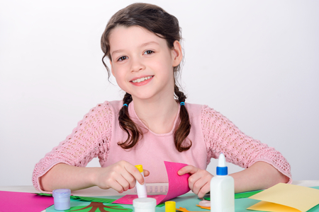 Young girl making craft card Stock Photo