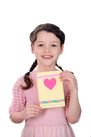 Girl showing a greeting card