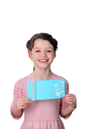 Joyous girl holding handmade card Stock Photo
