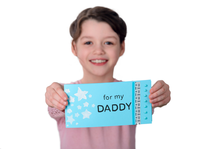 Young girl holding a Greetings for her daddy