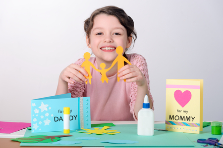 Girl making gift for parents