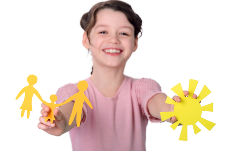 Girl holding cutout paper shapes Stock Photo