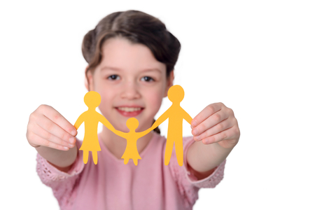 Girl showing paper chain family Stock Photo