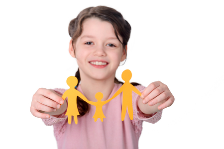 Girl holding paper chain family Stock Photo