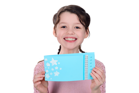 Girl showing a handmade card