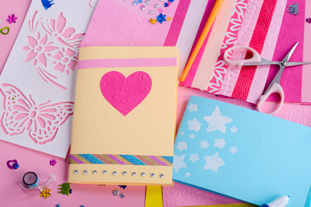 Greeting card with pink heart 写真素材