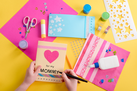 Girl writing on greeting card Stock Photo