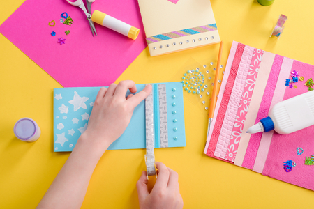 Girl decorating a greeting card