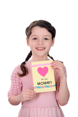 Beautiful girl holding greeting card