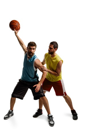 Two basketball players on white
