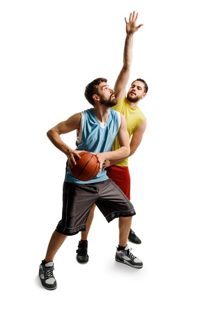 Friends playing basketball on white