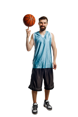 Basketball player spinning a ball Stock Photo