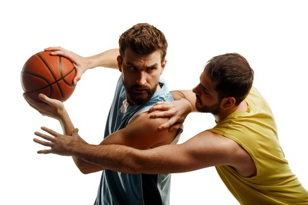 Muscular basketball players on white