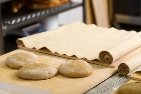 Formed loaves on dough board