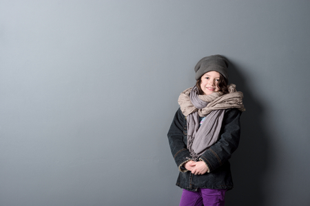 Beautiful girl on grey background