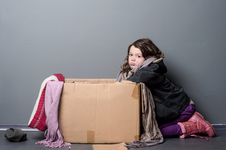 Upset girl leaning over box