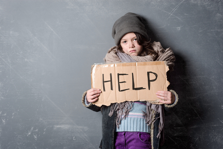 Sad girl holding Help sign