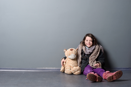 Happy girl and old toy Stock Photo