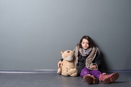 Tired girl hugging old toy