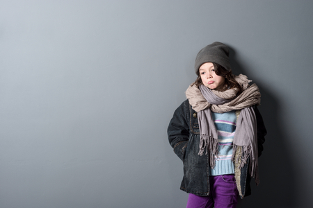 Girl wearing old clothes Stock Photo