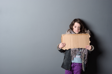 Girl holding piece of paper Stock Photo