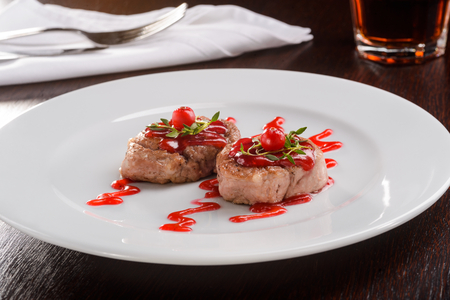 Veal medallions with cranberry sauce Stock Photo - 111178518