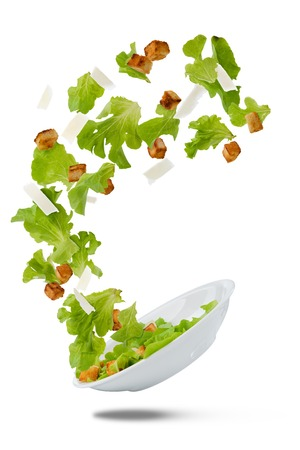 Flying salad over white background