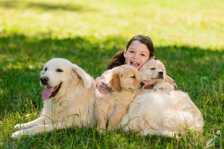 Girl and her golden retrievers