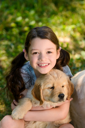 Girl is holding a puppy