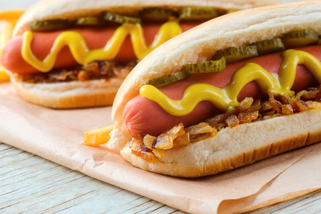 Tasty hot dogs with mustard