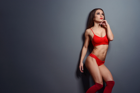 Sultry chick in red sportswear