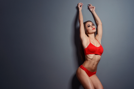 Fit girl with raised hands
