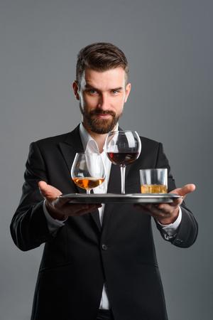 Waiter serving for tasting session