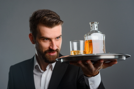 Expert evaluating color of whisky