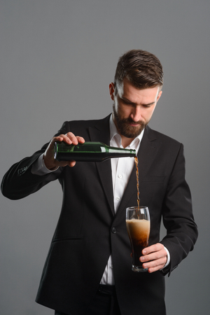 Connoisseur pouring beer into glass Stock Photo
