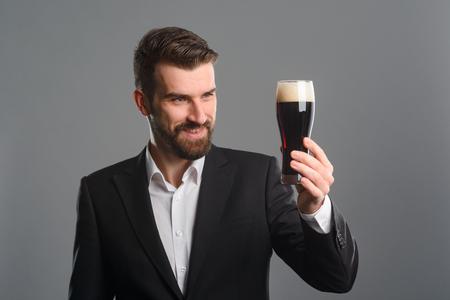 Man staring at beer glass Stock Photo