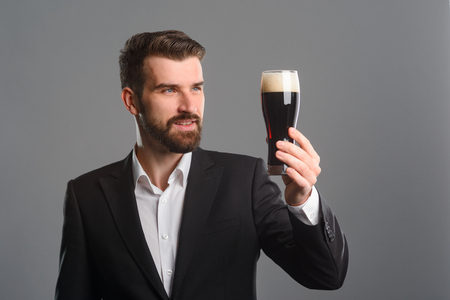 Smiling man holding beer glass Stock Photo