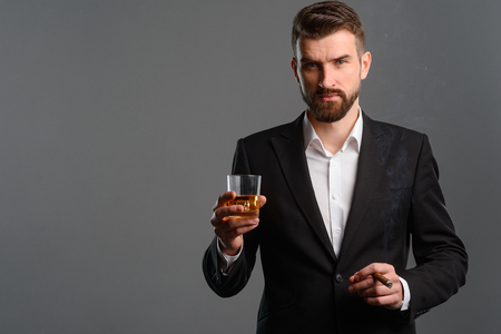Gentleman having drink and cigar 스톡 콘텐츠 - 111417735
