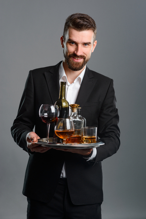 Sommelier carrying tray with beverages Stock Photo